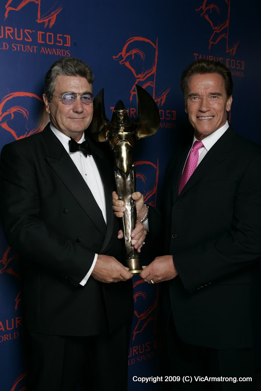 Vic Armstrong with Arnold Schwarzenegger and Taurus award